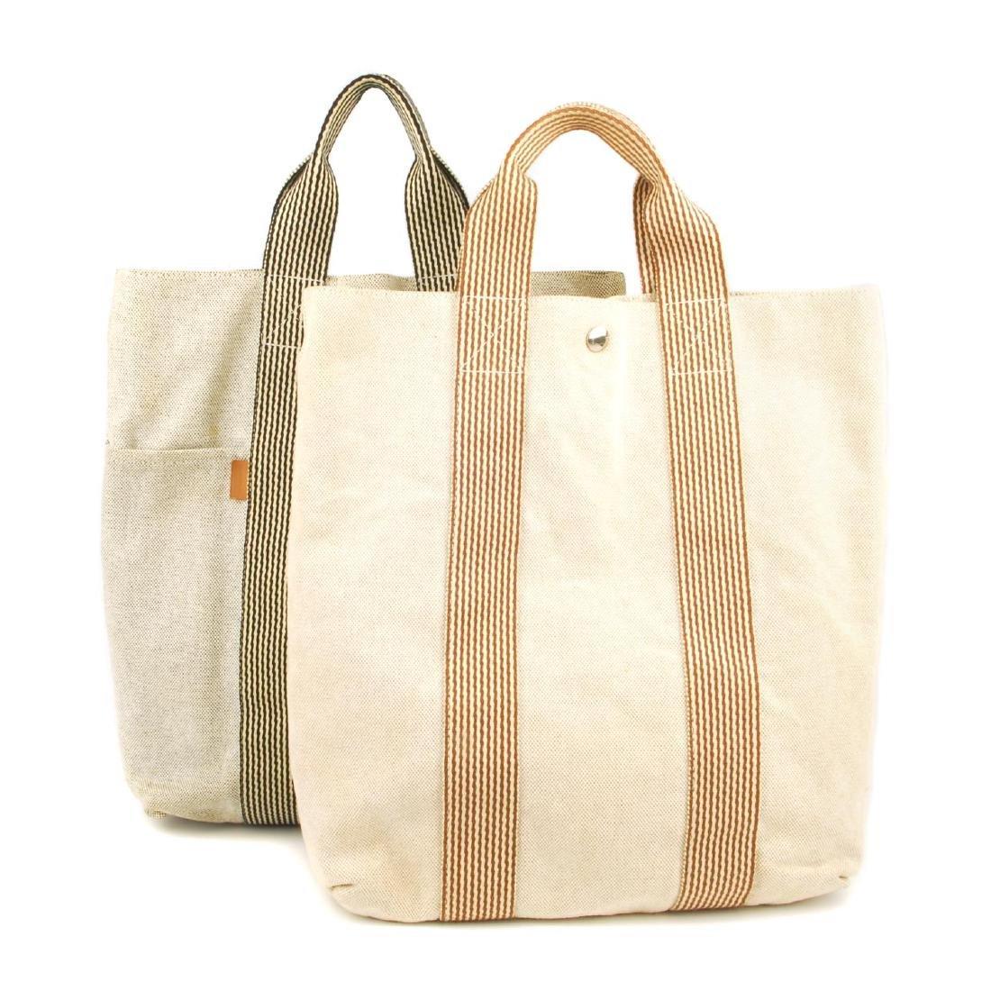HERMÈS - two Fourre Tout canvas handbags. Both of a