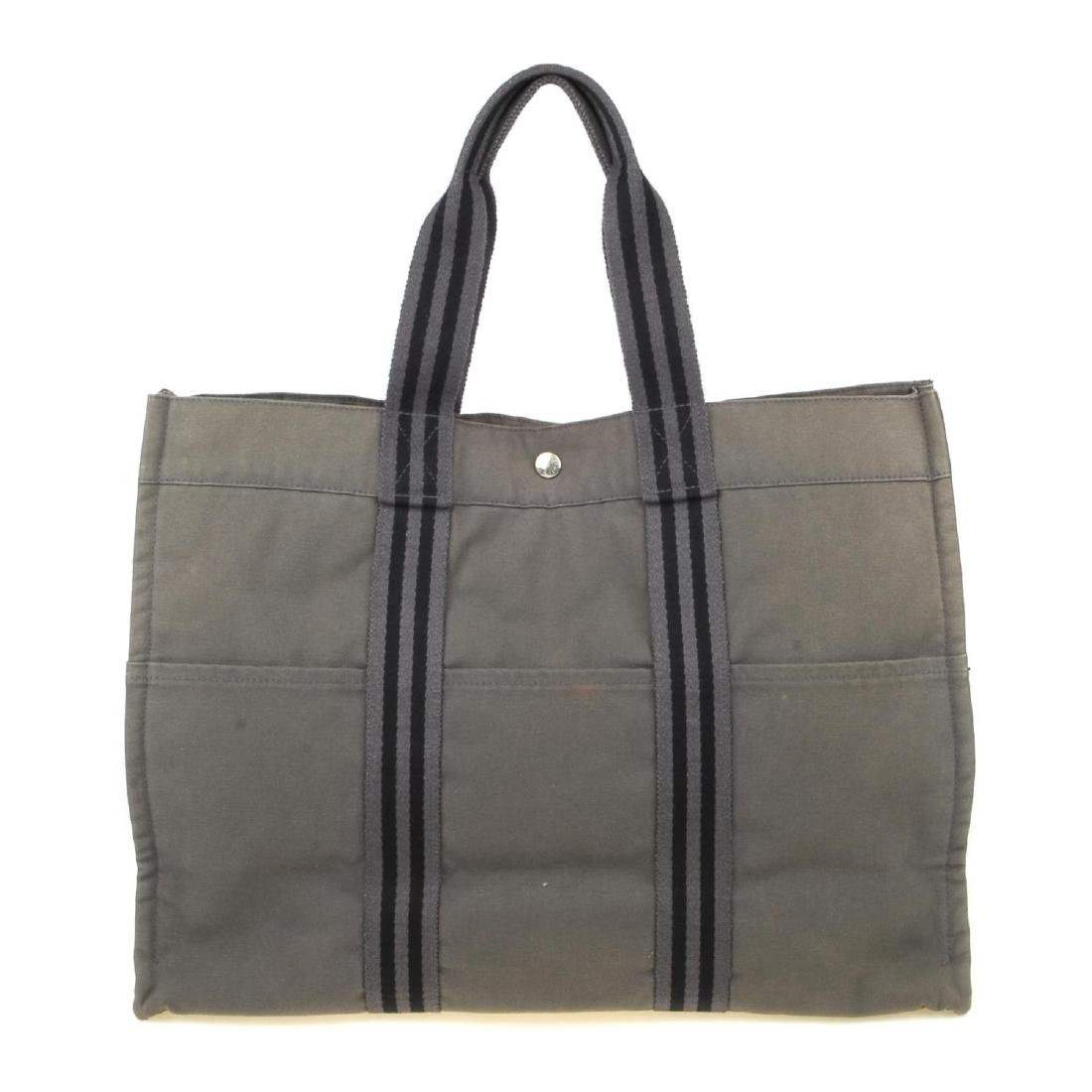HERMÈS - a Fourre Tout canvas GM handbag. Crafted from