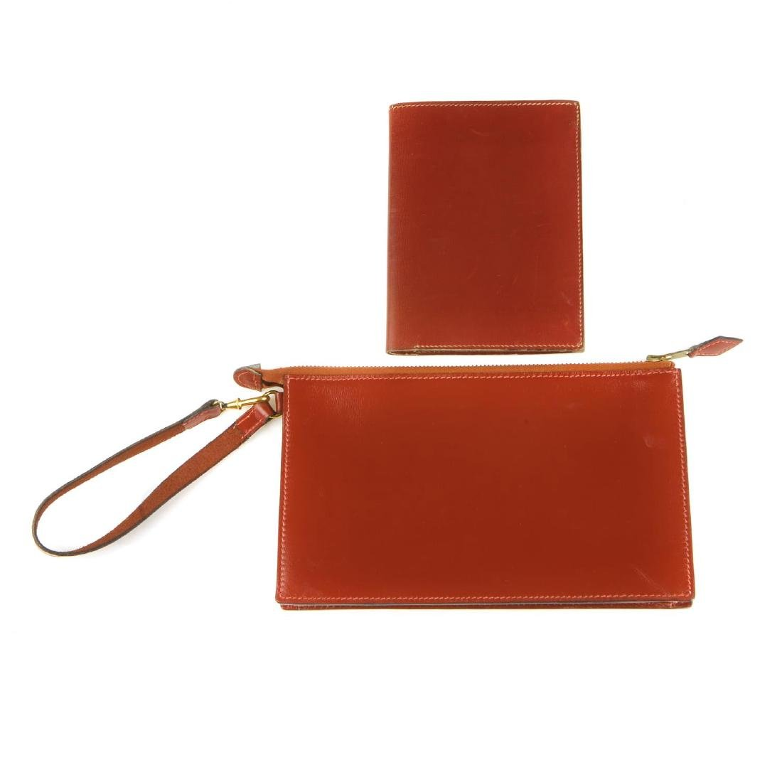 HERMÈS - a leather pouch and wallet. Both crafted from