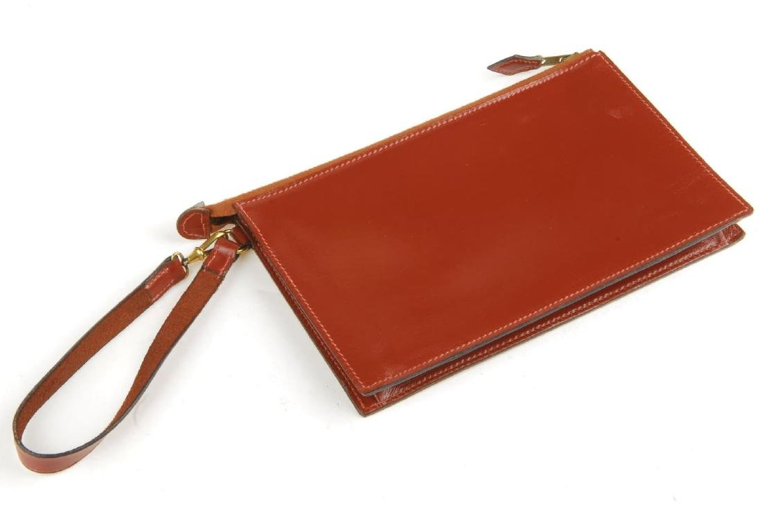 HERMÈS - a leather pouch and wallet. Both crafted from - 2