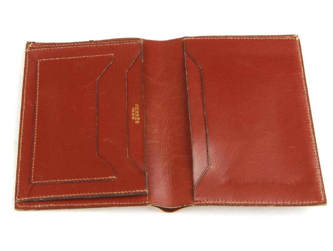 HERMÈS - a leather pouch and wallet. Both crafted from - 3