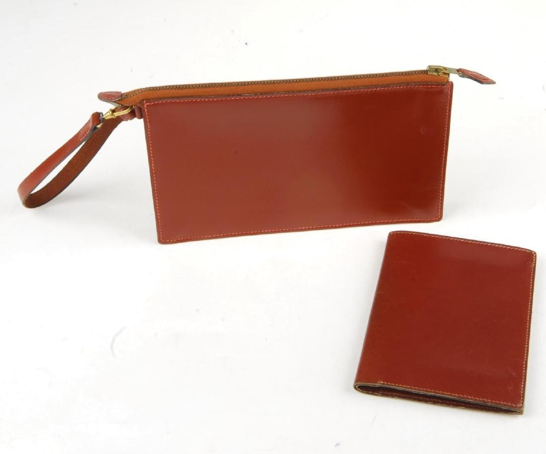 HERMÈS - a leather pouch and wallet. Both crafted from - 4
