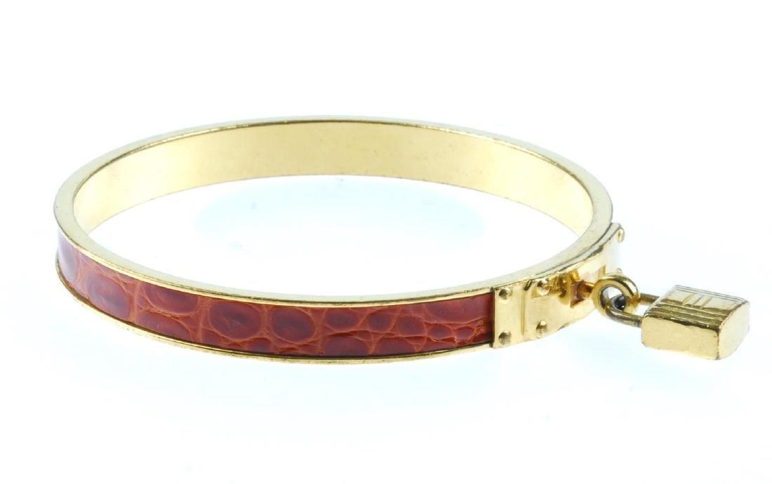 HERMÈS - a Kelly bangle. The circular gold-tone bangle - 2