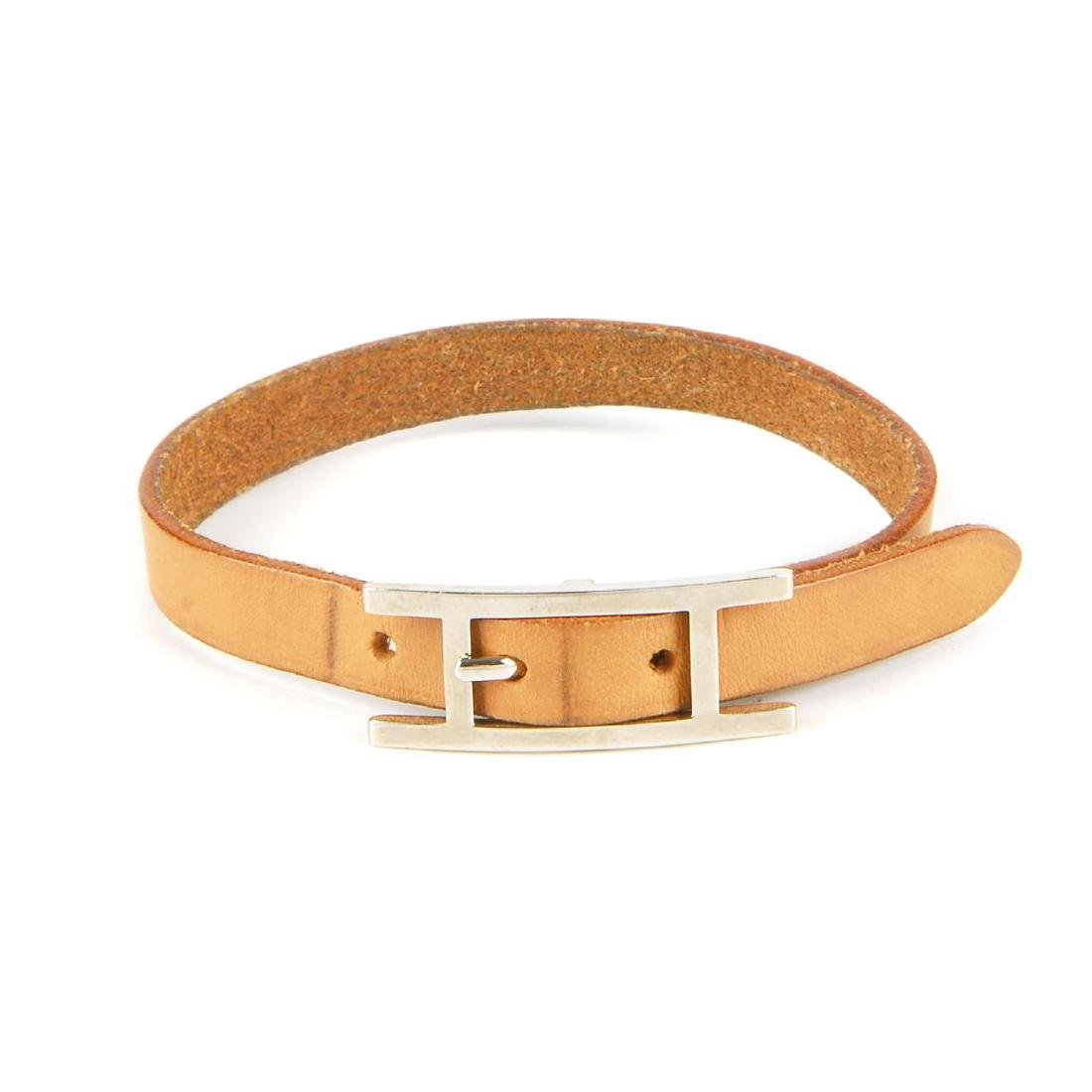 HERMÈS - a leather bracelet. Designed as a tan leather