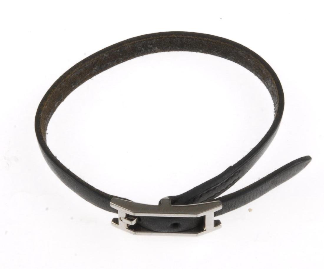 HERMÈS - a black leather bracelet. The silver-tone - 2