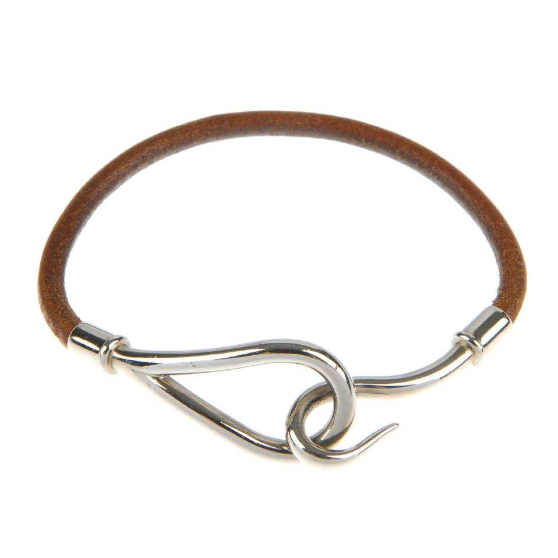 HERMÈS - a leather cord bracelet. The brown leather