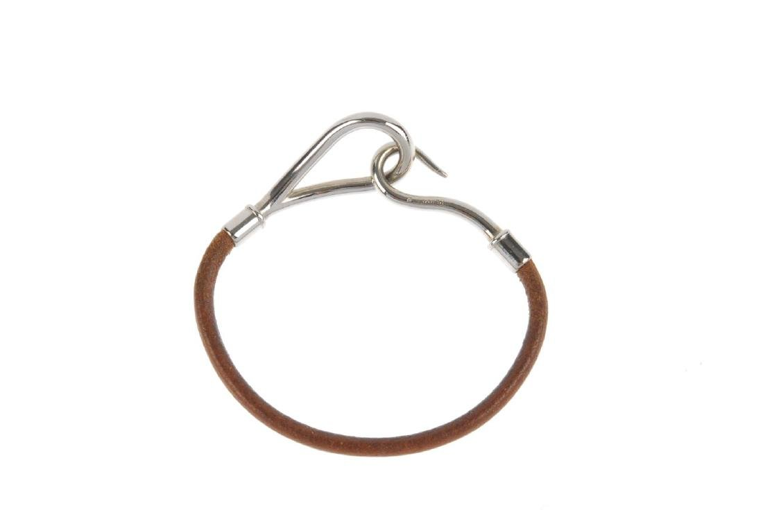 HERMÈS - a leather cord bracelet. The brown leather - 2