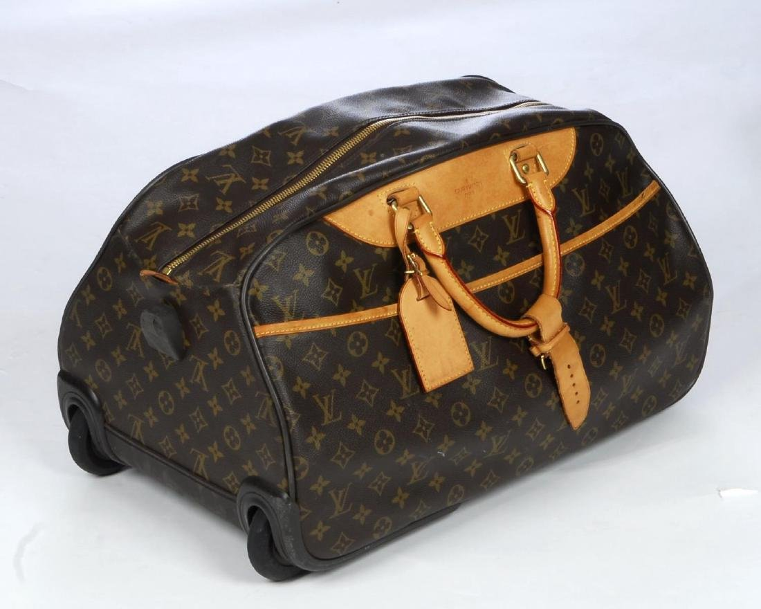 LOUIS VUITTON - a Monogram Eole 50 rolling duffle bag. - 2