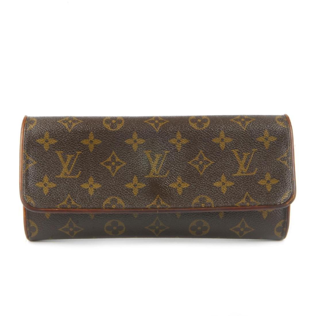 LOUIS VUITTON - a Monogram Pochette Twin GM handbag.