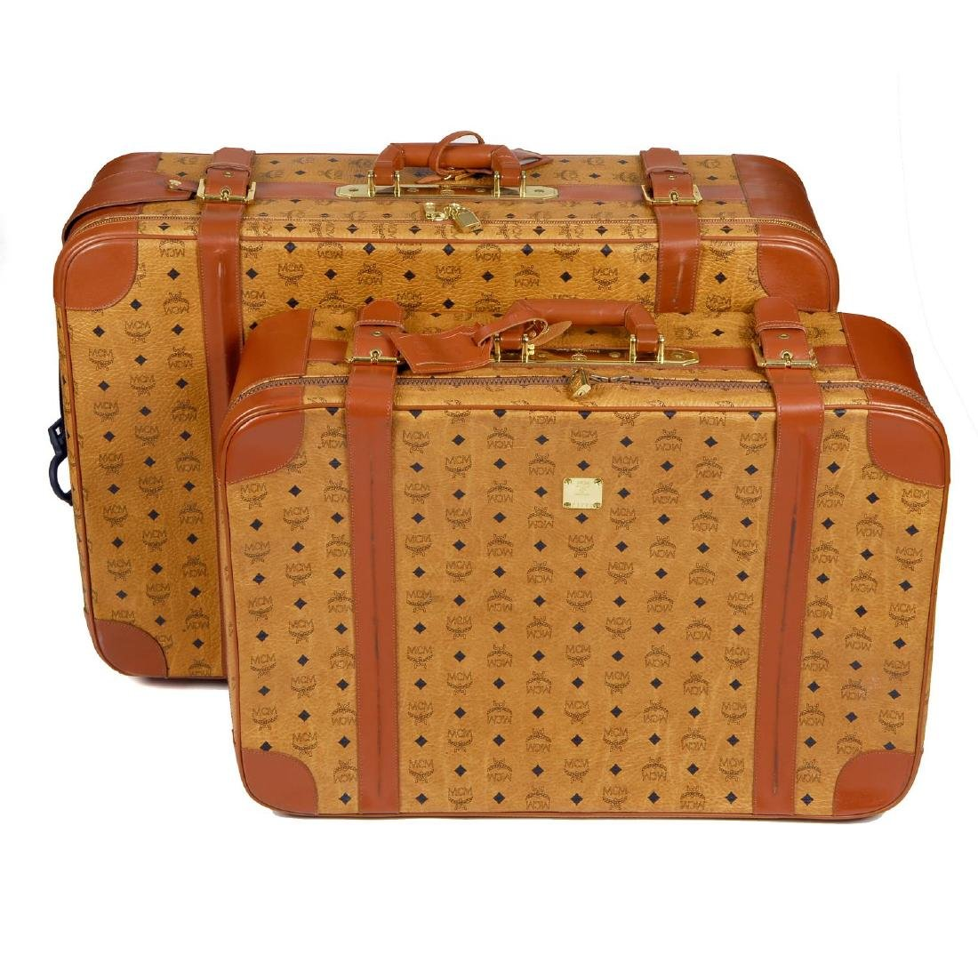 MCM - two vintage travel suitcases. To include a larger