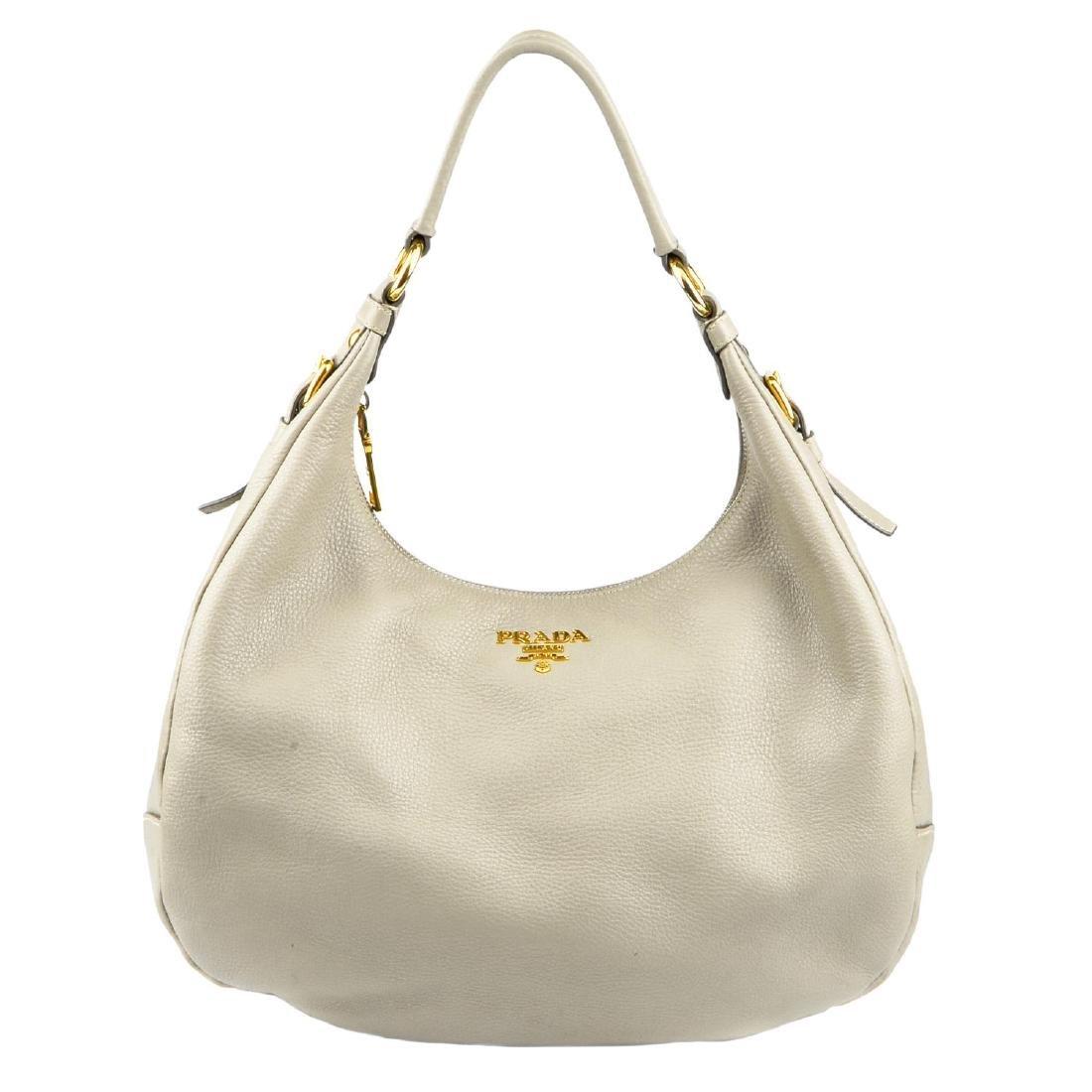 PRADA - a grey leather hobo handbag. Designed with a