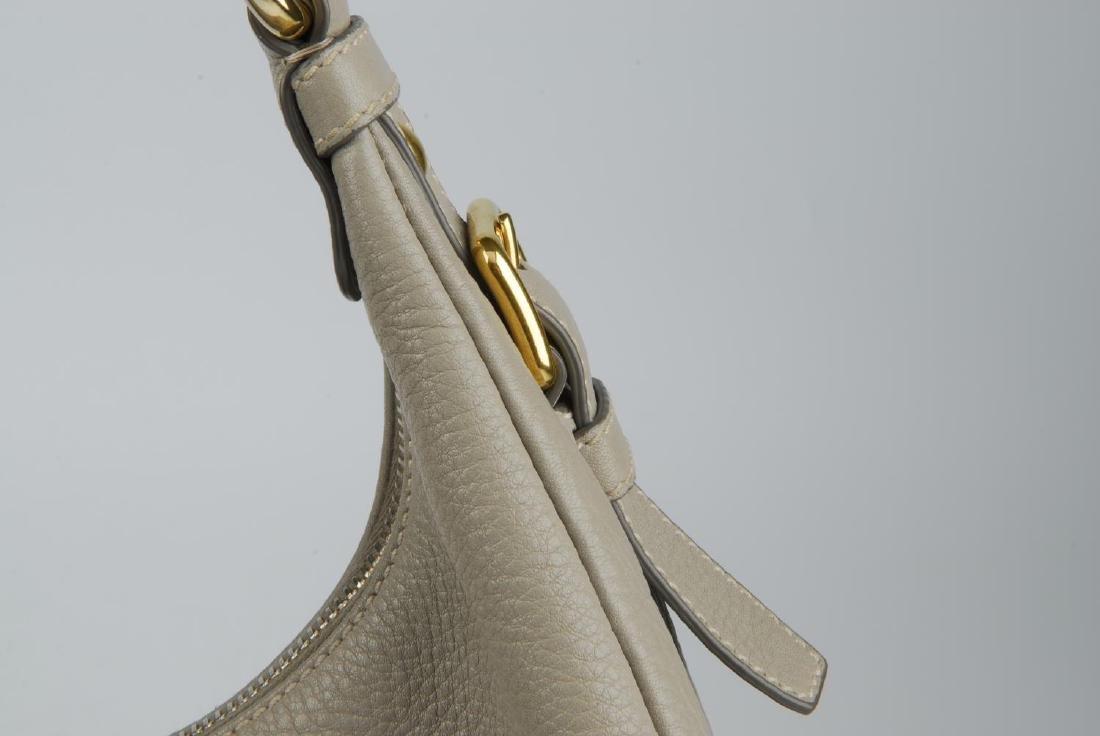 PRADA - a grey leather hobo handbag. Designed with a - 2