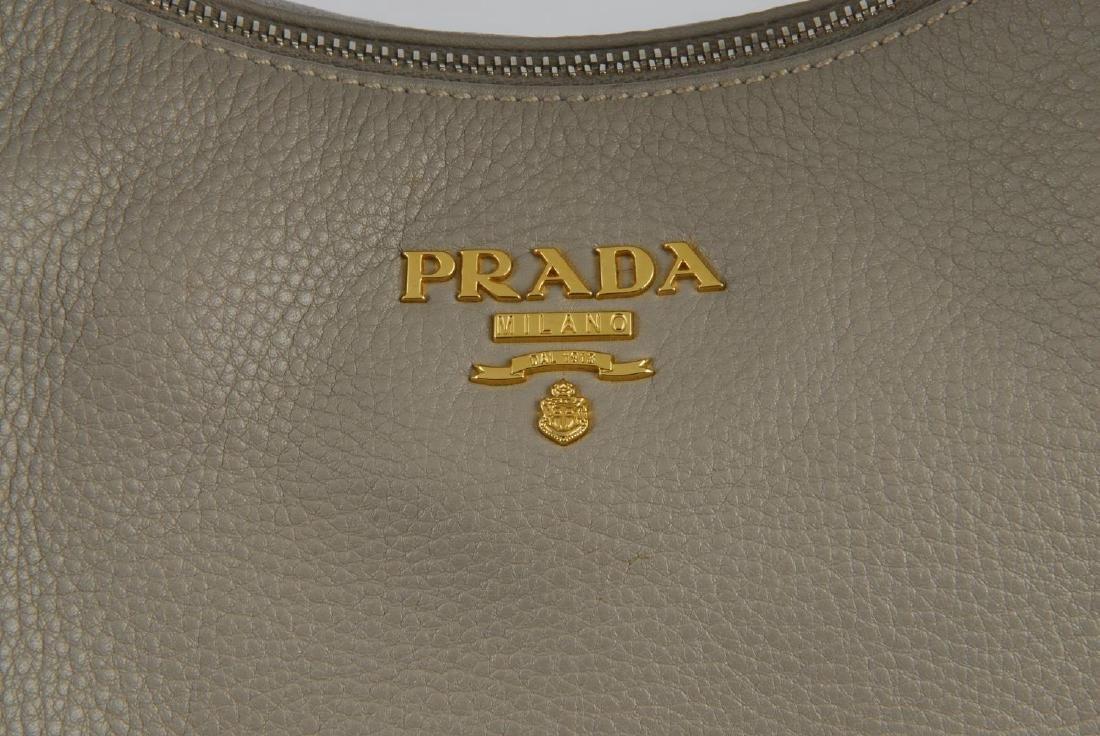 PRADA - a grey leather hobo handbag. Designed with a - 4