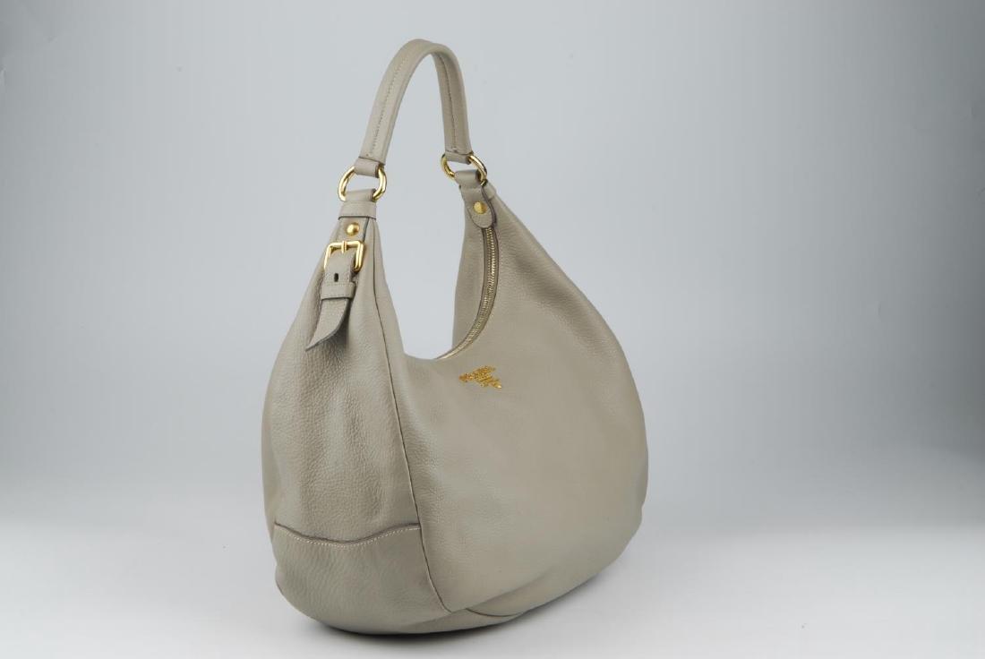 PRADA - a grey leather hobo handbag. Designed with a - 5