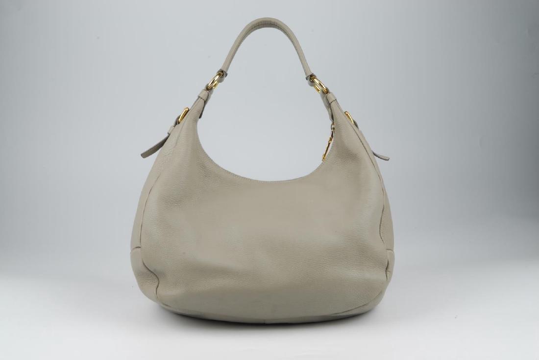 PRADA - a grey leather hobo handbag. Designed with a - 6