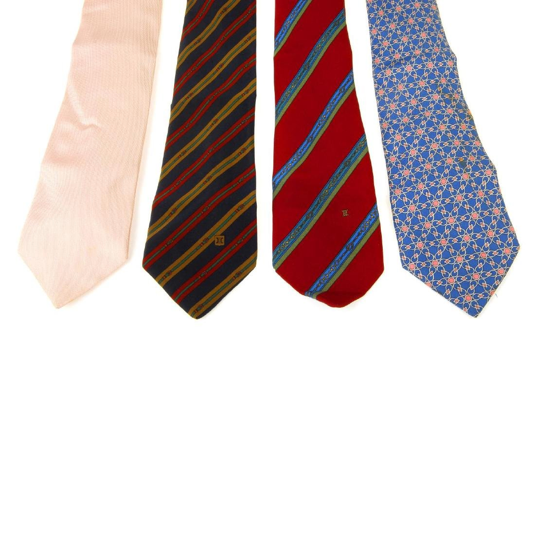 Eight ties. To include three Céline ties, two Gucci
