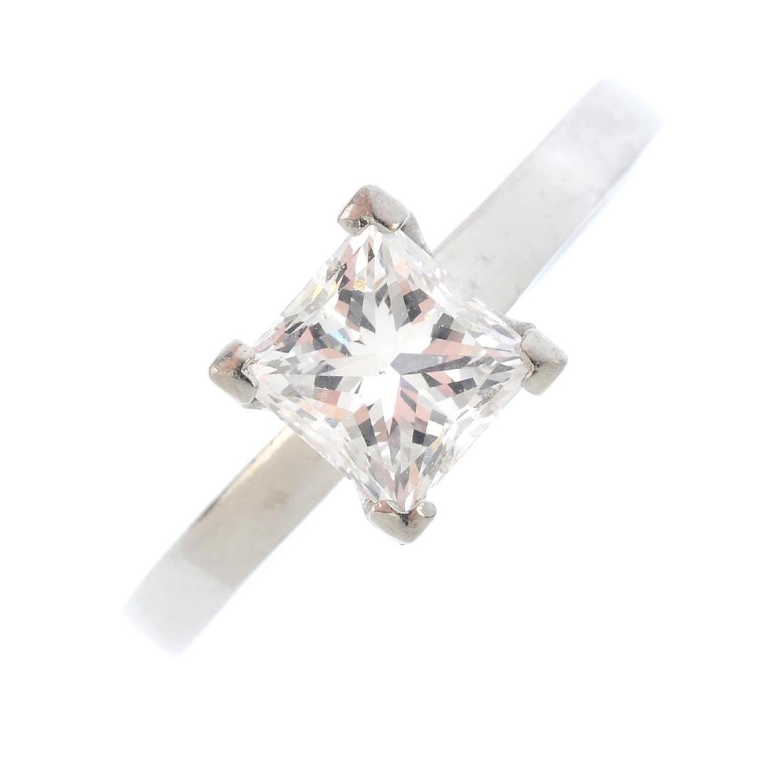 A diamond single-stone ring. The square-shape diamond,