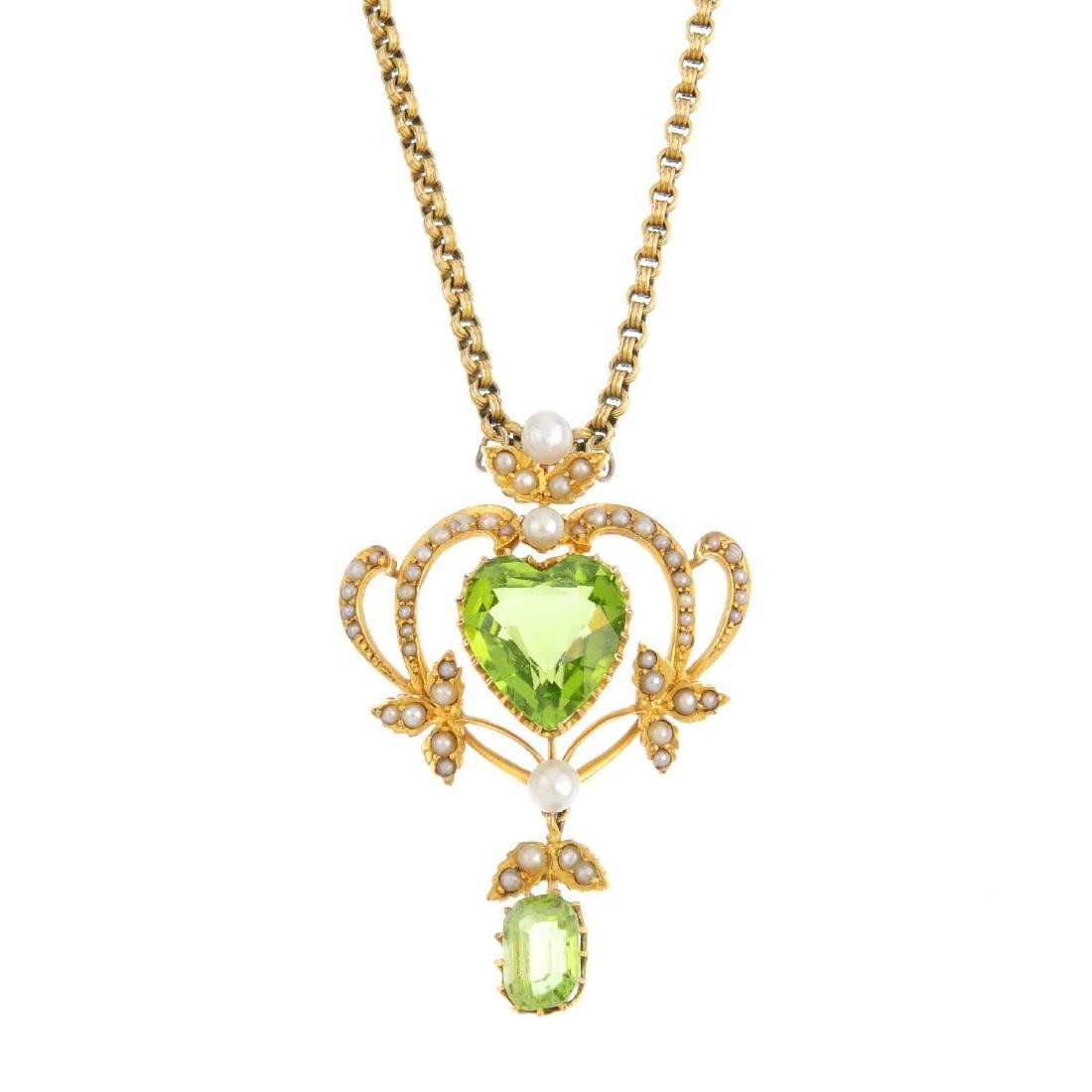 An Edwardian 15ct gold peridot and pearl pendant. The