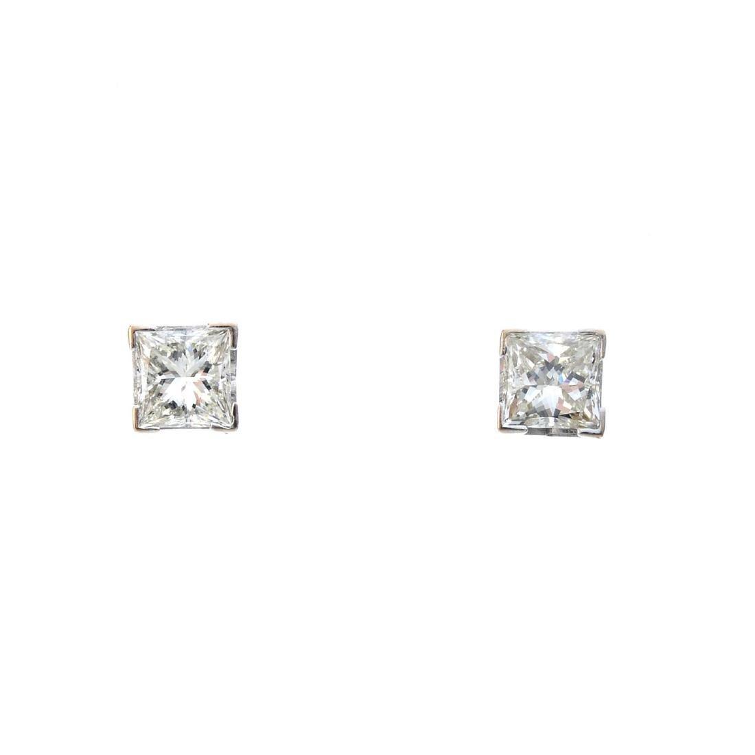 A pair of square-shape diamond stud earrings. Estimated