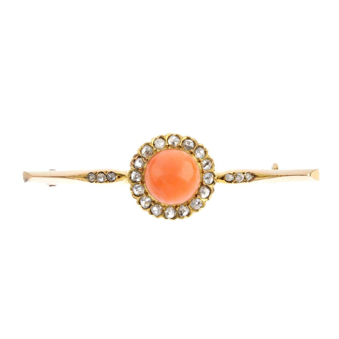 An early 20th century gold, coral and diamond bar