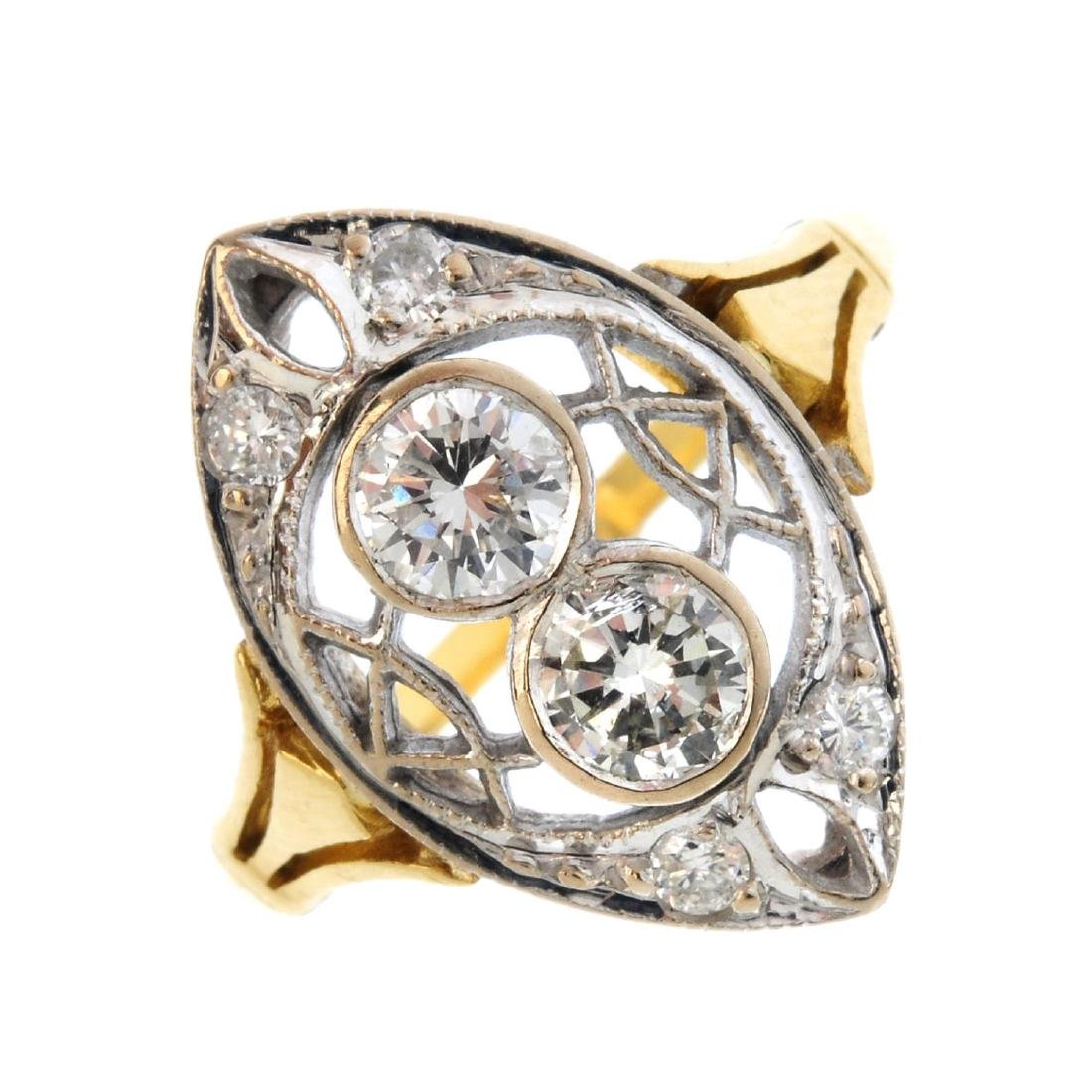 An early 20th century gold diamond dress ring. Of