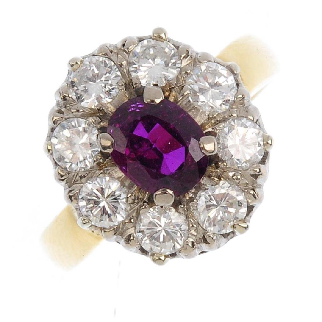 An 18ct gold ruby and diamond cluster ring. The