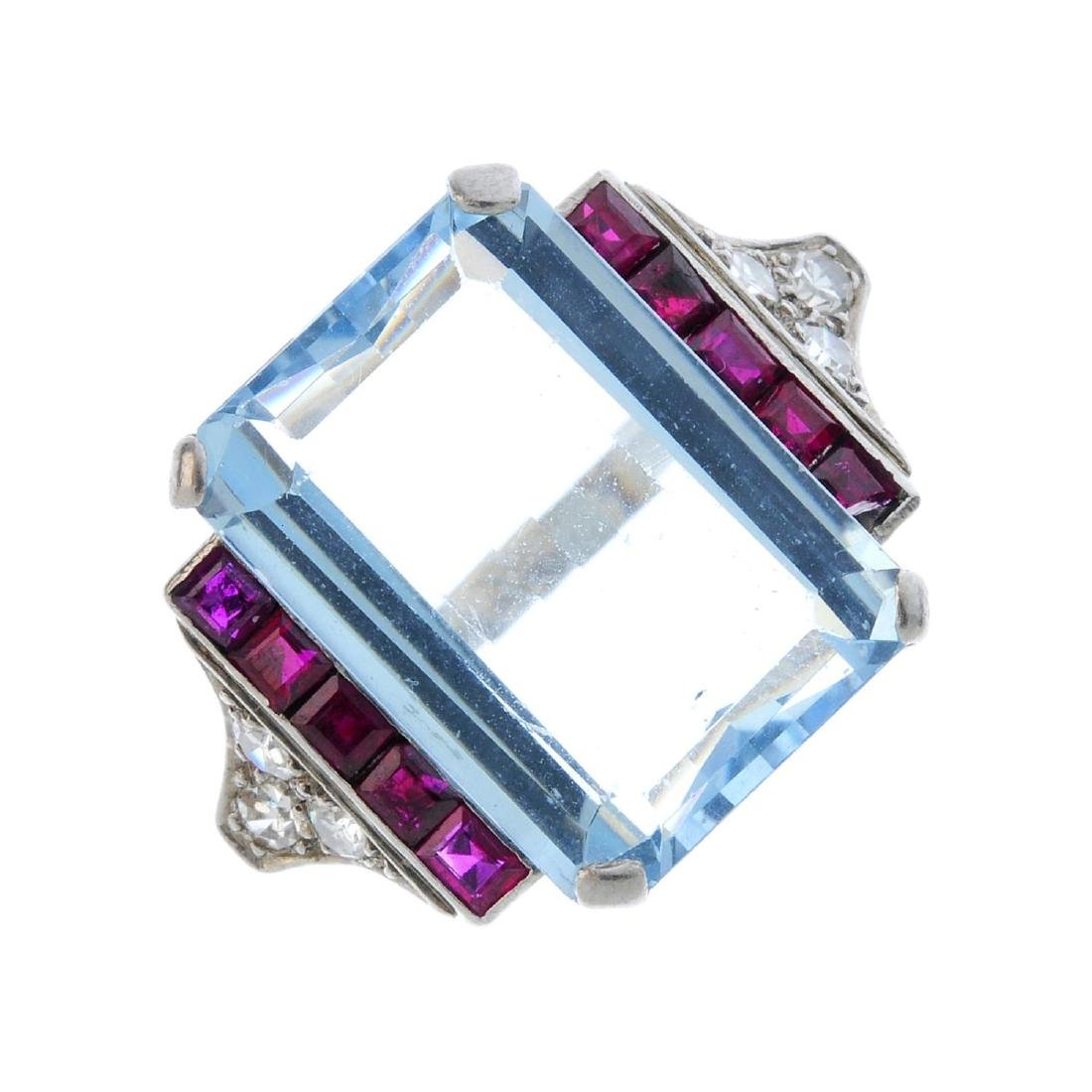 A 1940s aquamarine, ruby and diamond cocktail ring. The