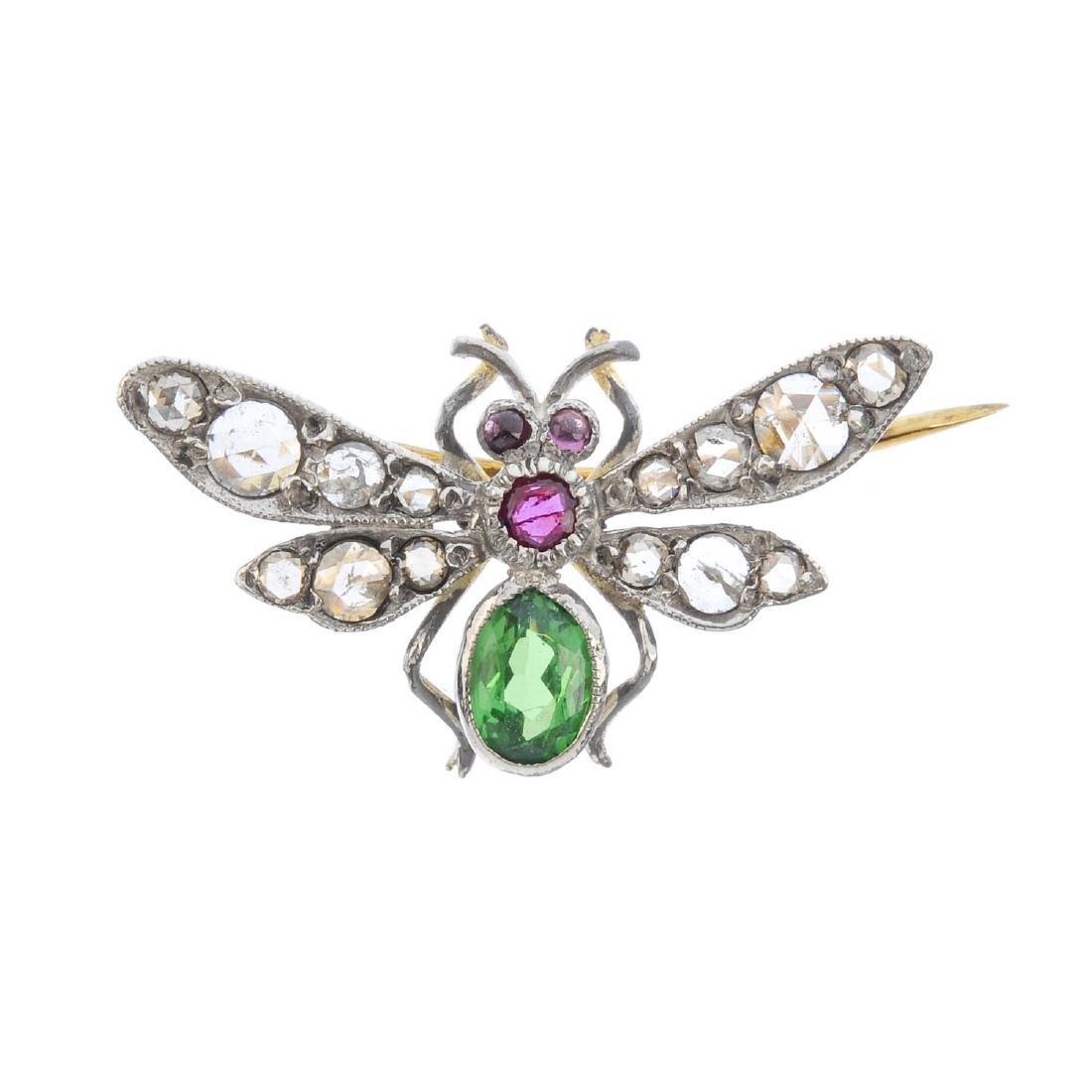 A diamond and gem-set bee brooch. The oval-shape