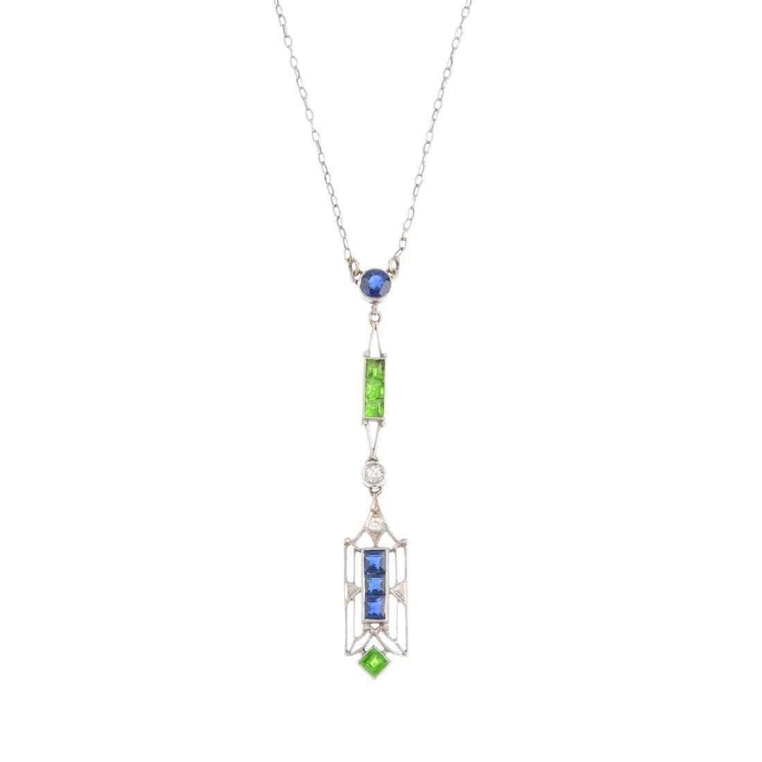 An Art Deco platinum, demantoid garnet diamond and