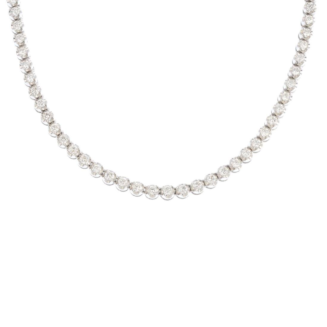 A diamond necklace. Designed as a series of
