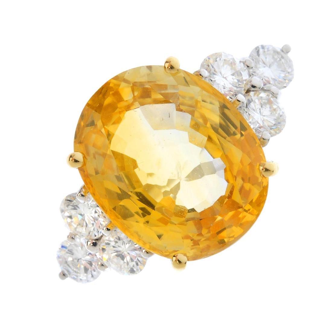 A sapphire and diamond dress ring. The oval-shape