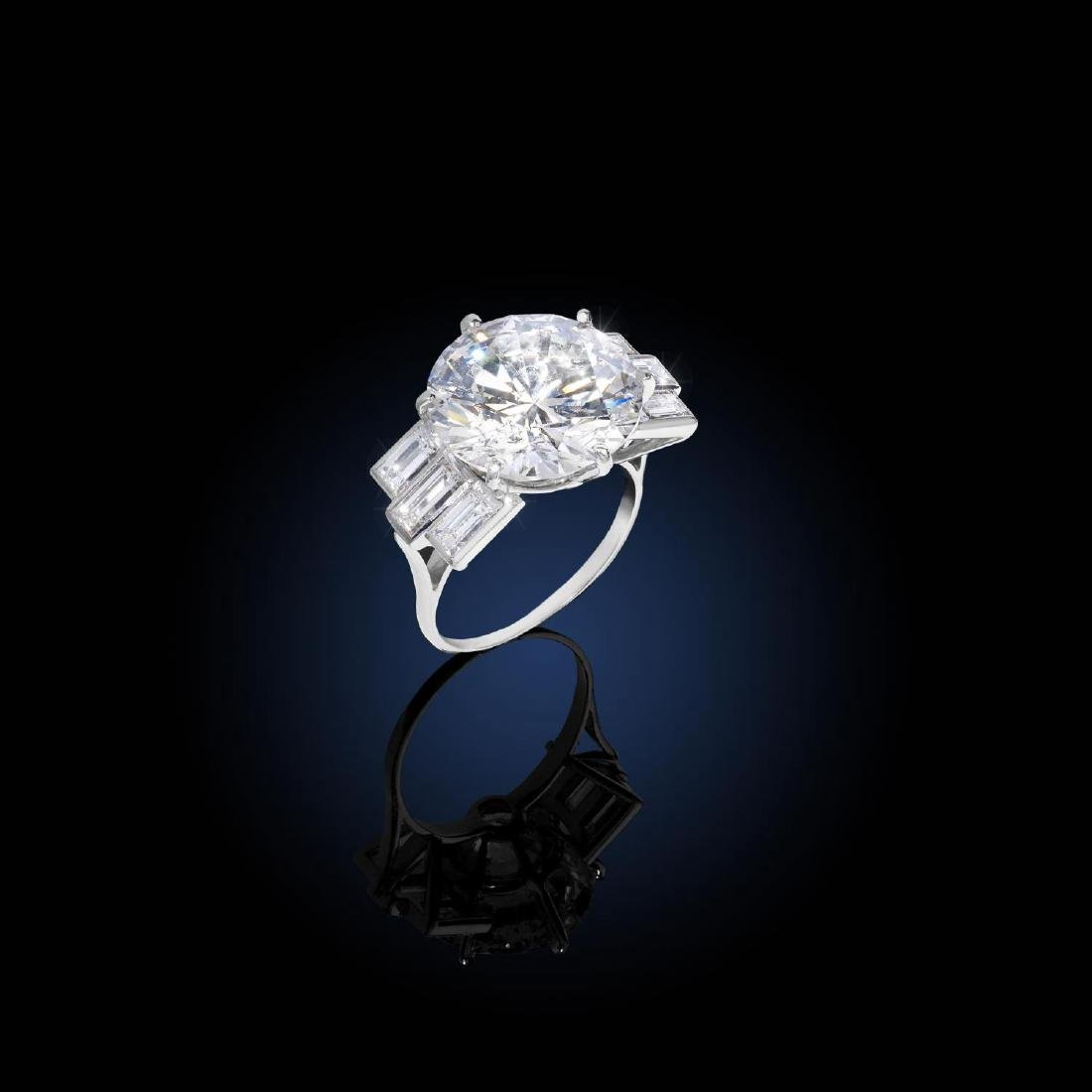 A diamond single-stone ring. The brilliant-cut diamond,
