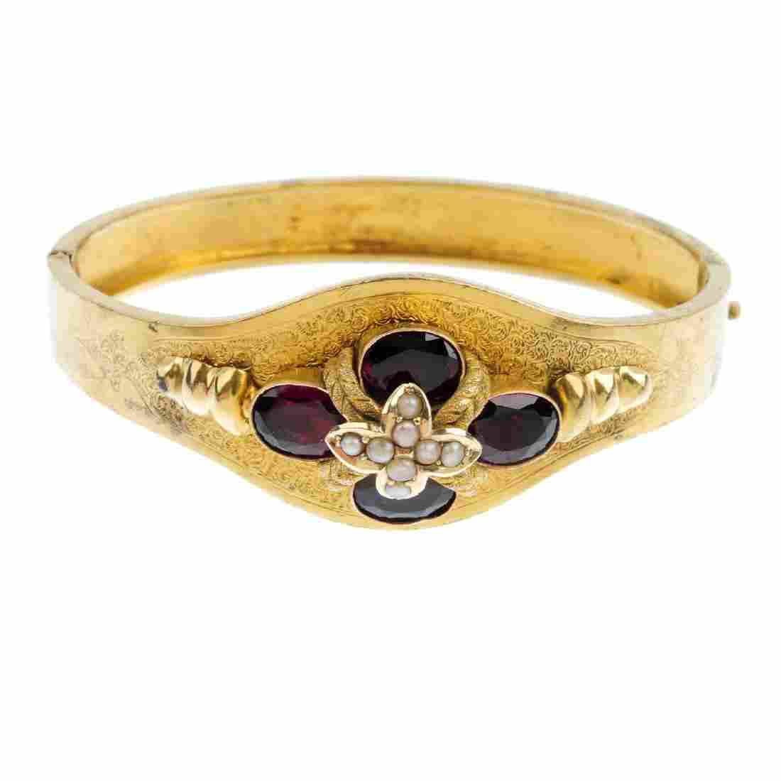 A late Victorian gold garnet and split pearl hinged