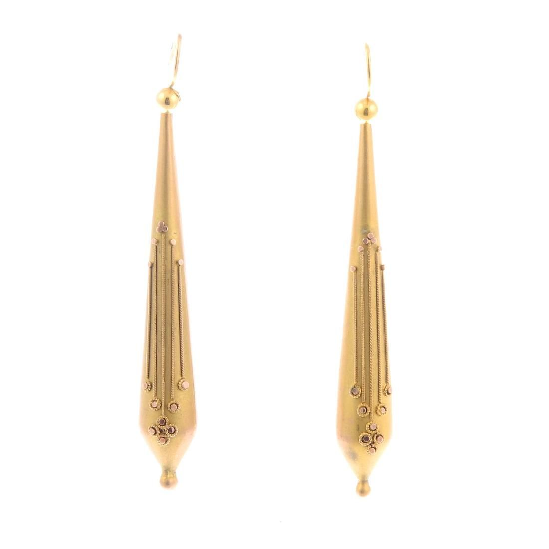 A pair of late Victorian 9ct gold earrings. Of