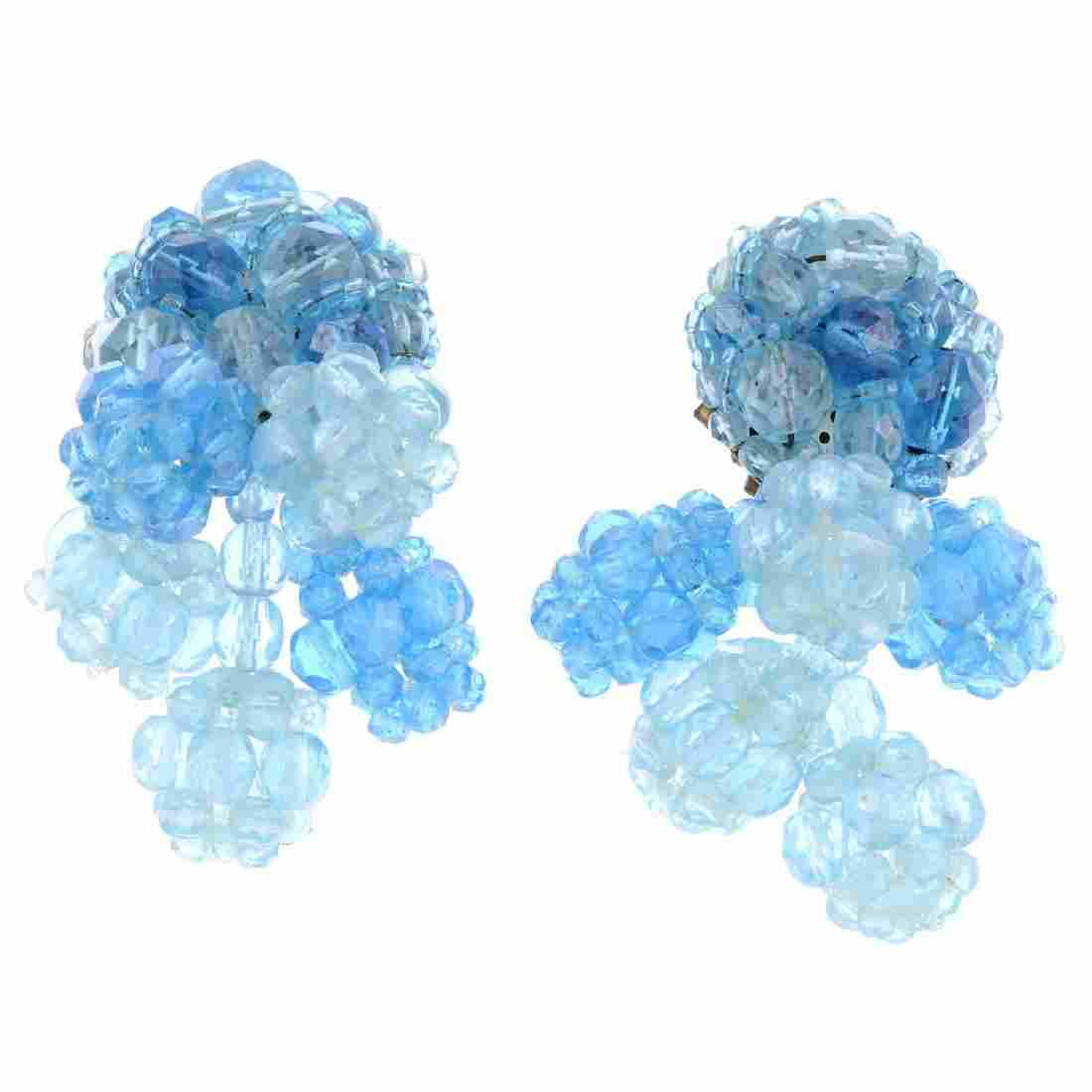 COPPOLA E TOPPO - a pair of earrings. Designed as two
