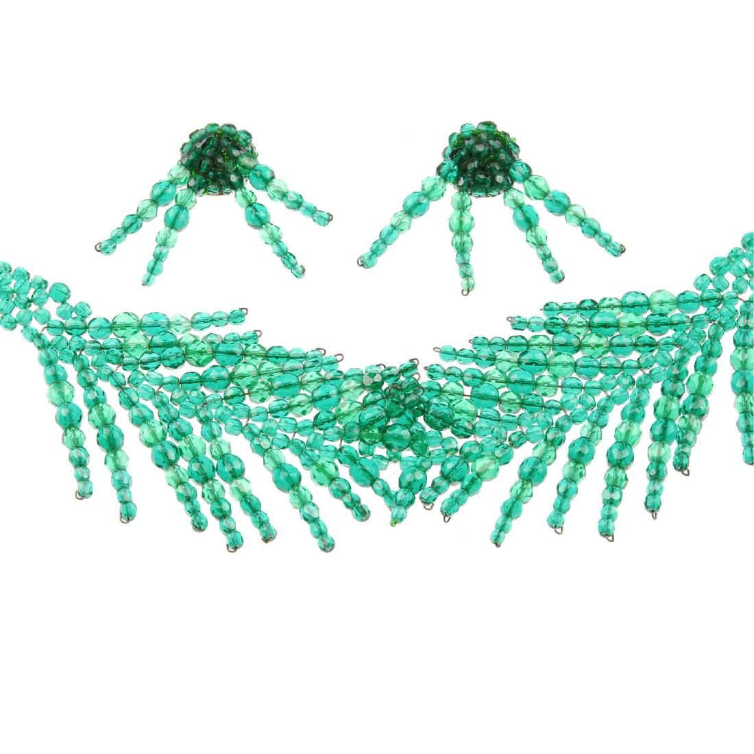 COPPOLA E TOPPO - a necklace with matching earrings.