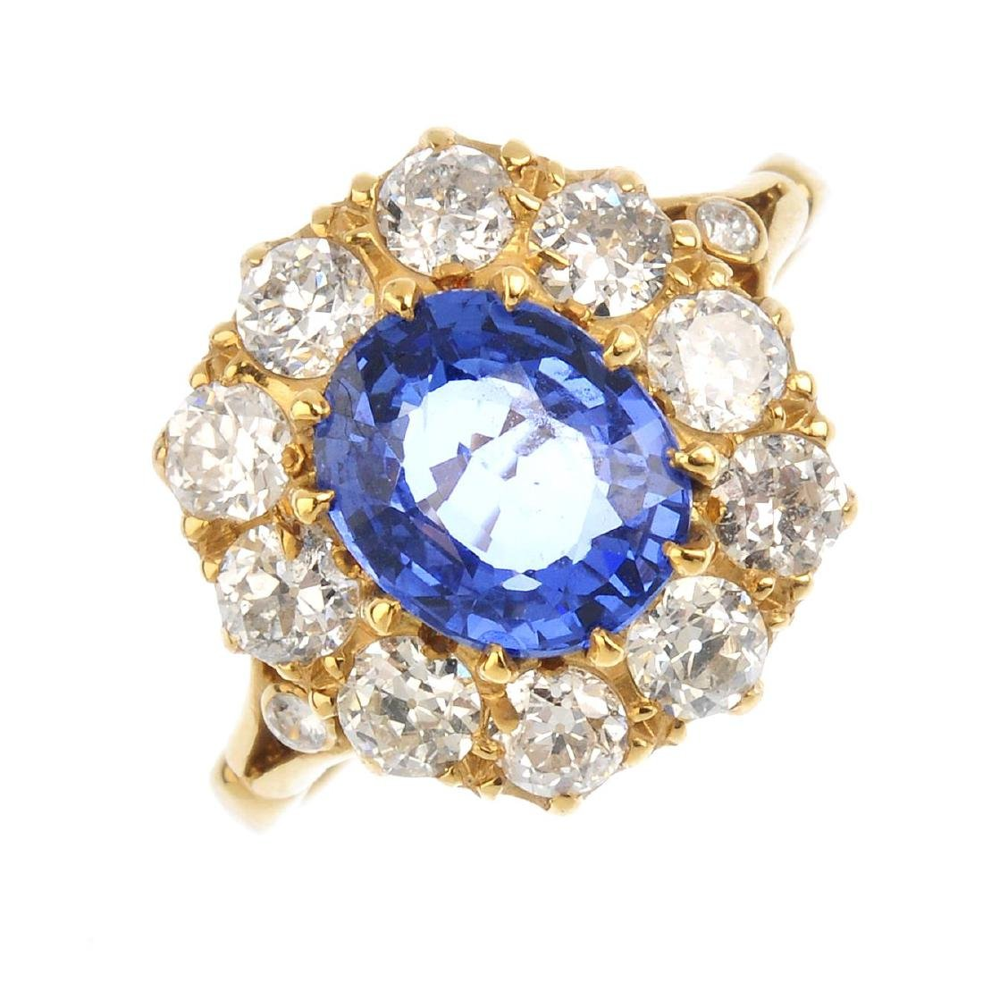 A sapphire and diamond cluster ring. The oval-shape