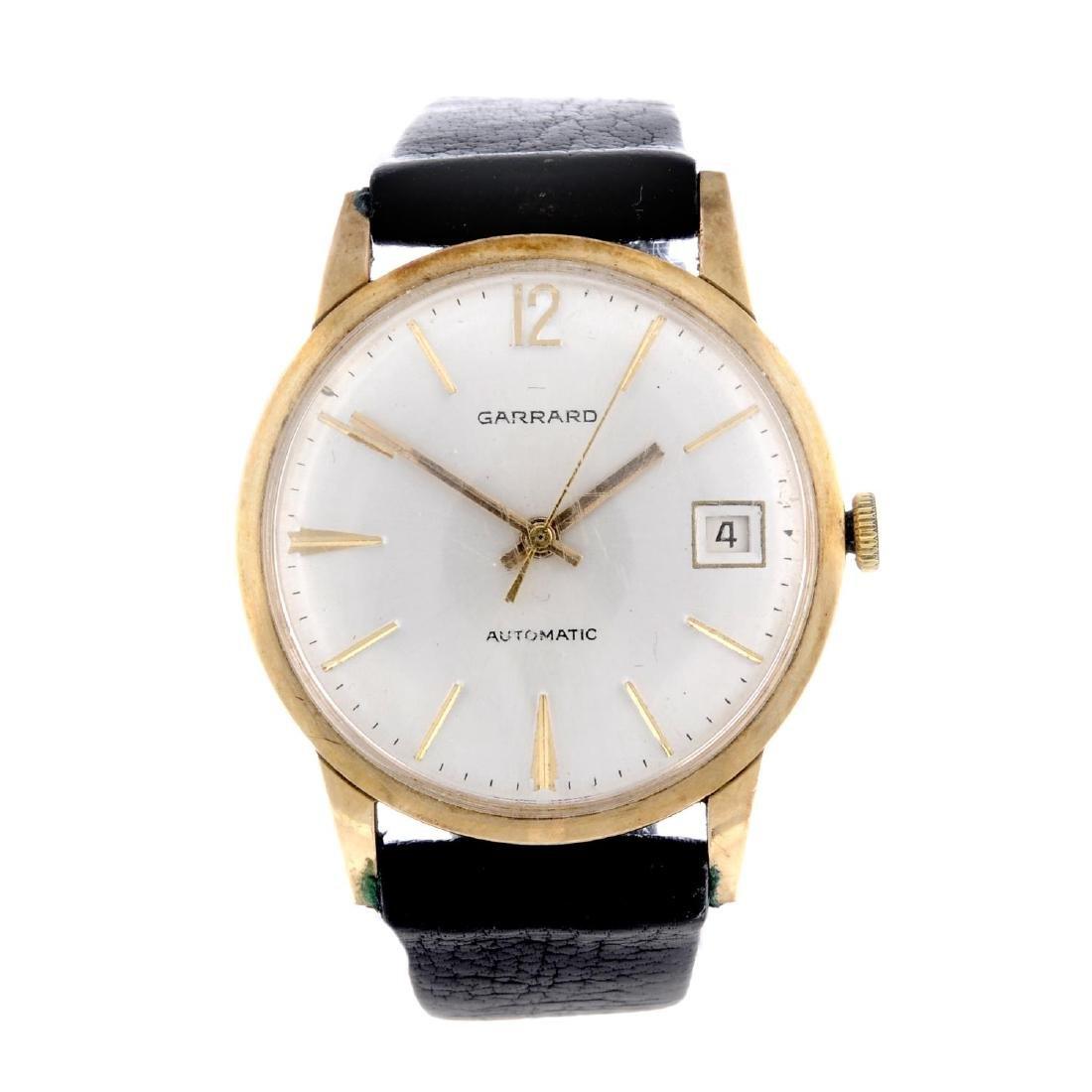 GARRARD - a gentleman's wrist watch. 9ct yellow gold