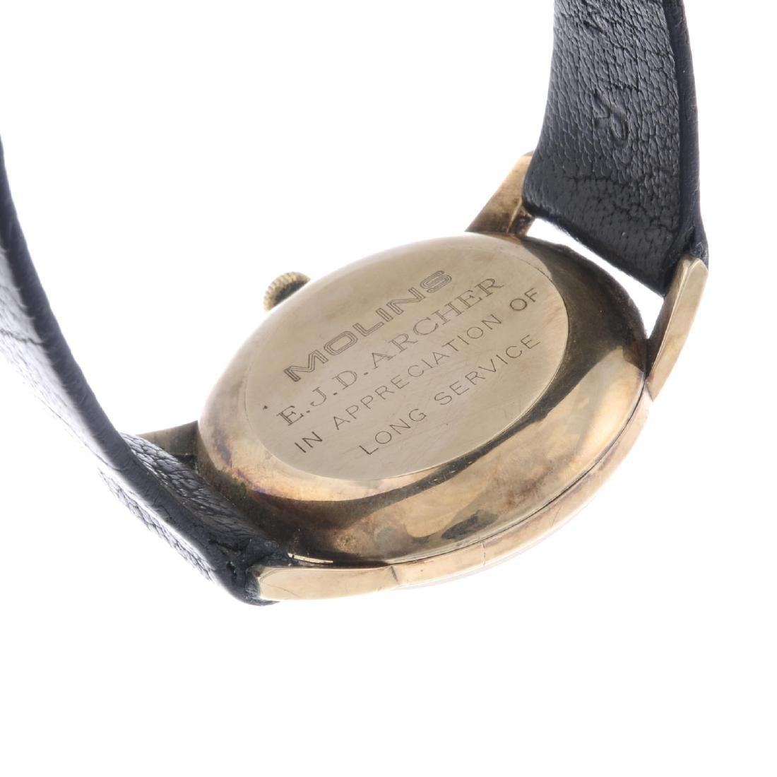 GARRARD - a gentleman's wrist watch. 9ct yellow gold - 3