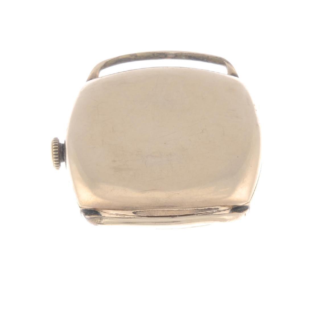 GARRARD - a gentleman's wrist watch. 9ct yellow gold - 6