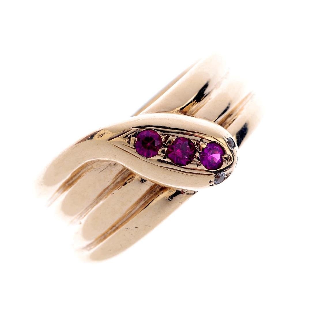 A 9ct gold synthetic ruby snake ring. Designed as a