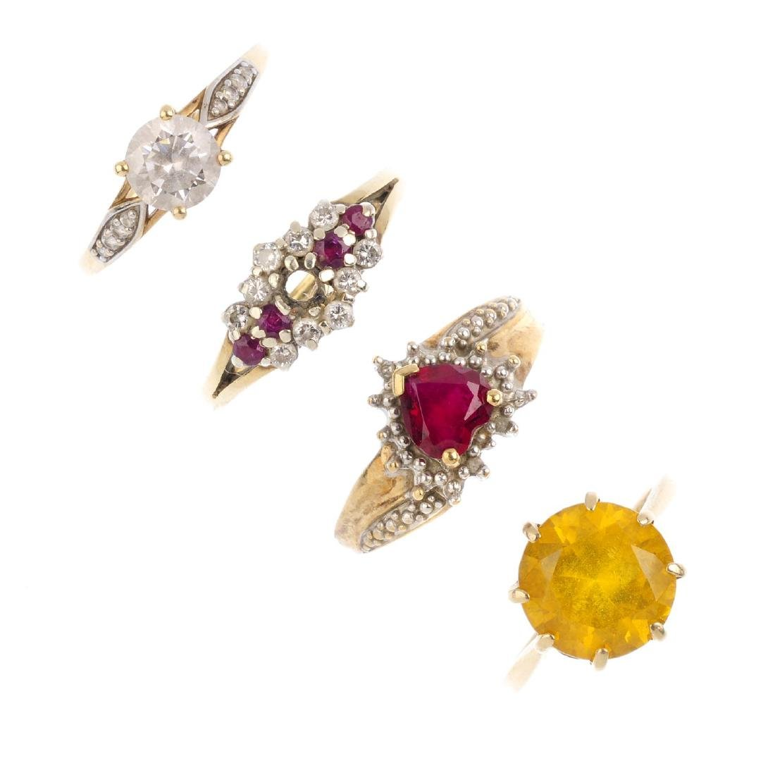 Four 9ct gold gem-set rings. To include a citrine