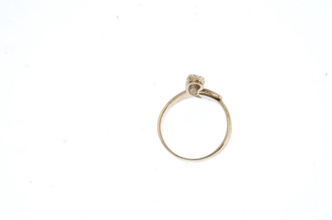 A 9ct gold snake ring. Designed as a coiled snake, with - 2