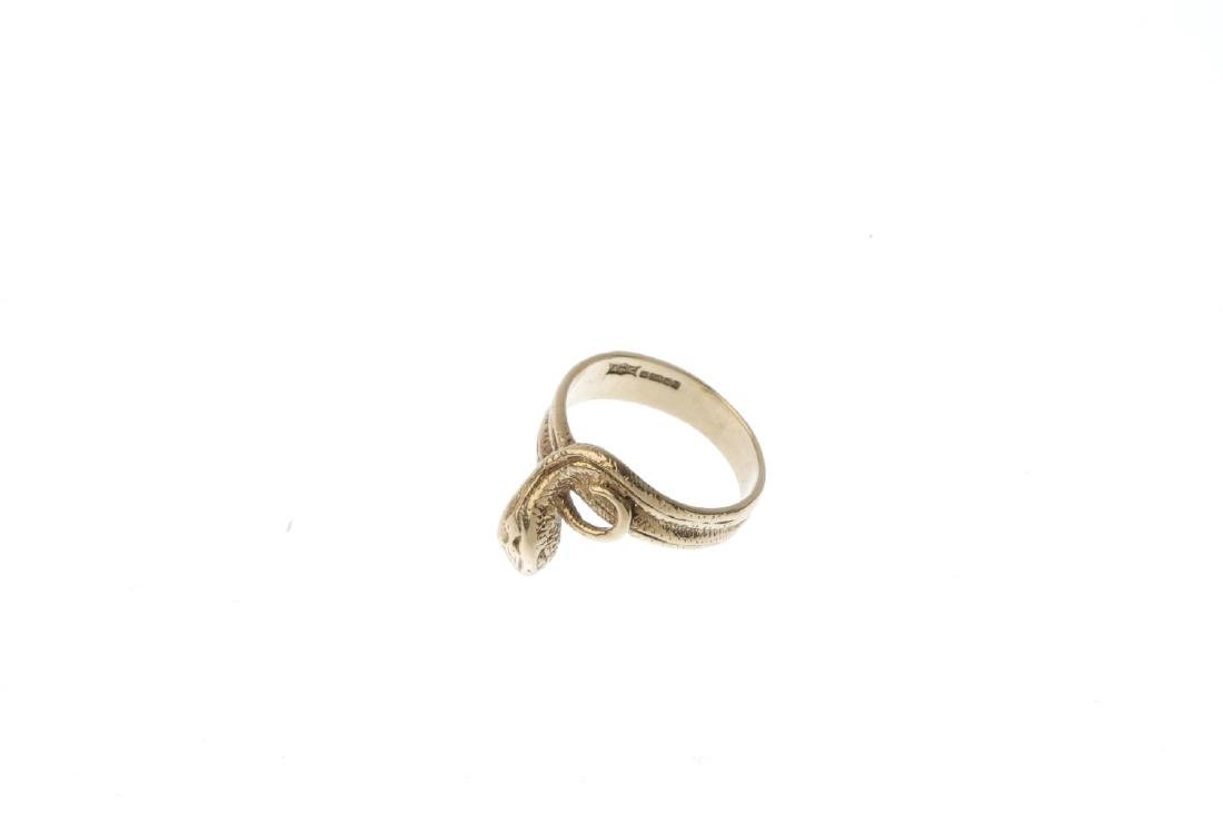 A 9ct gold snake ring. Designed as a coiled snake, with - 3