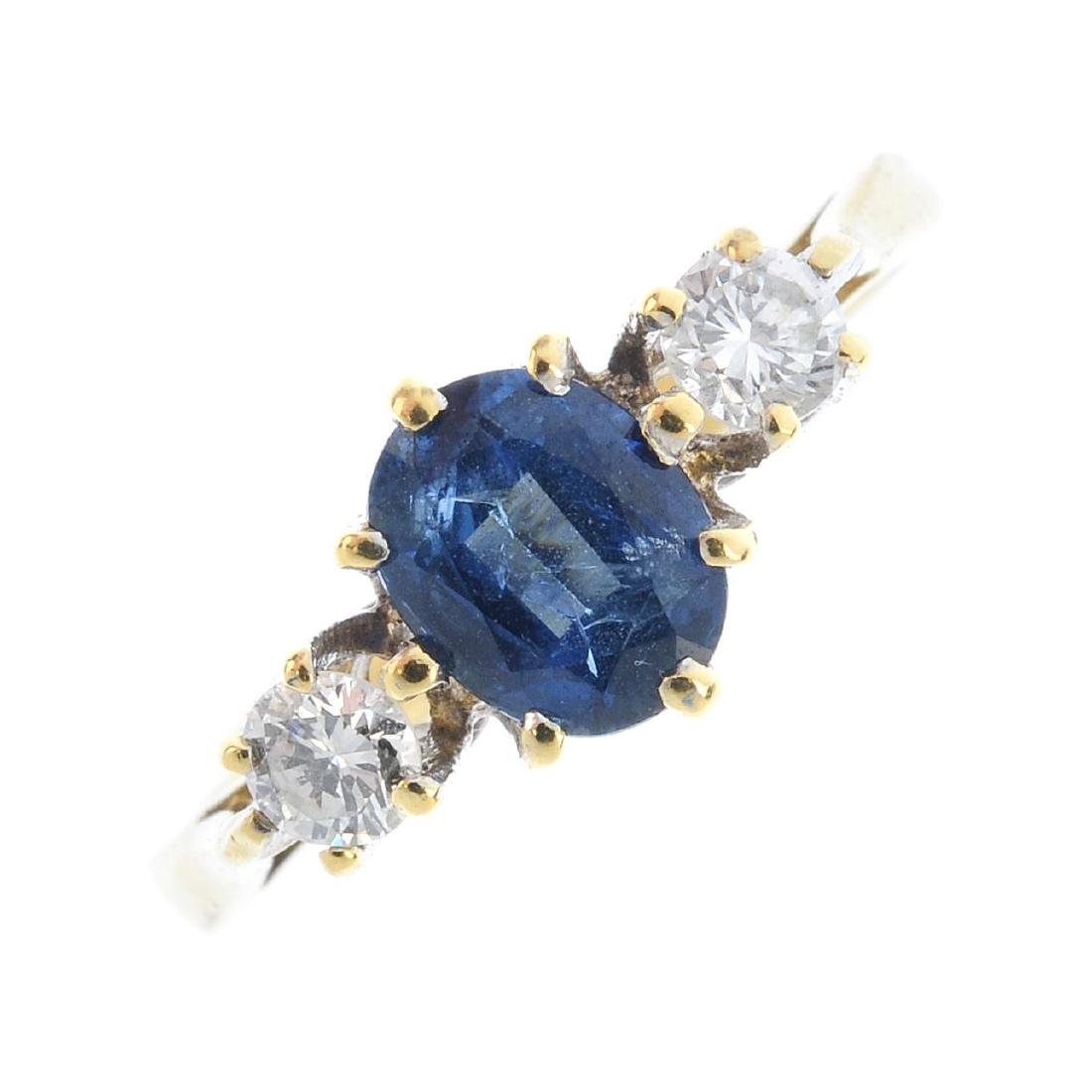 An 18ct gold sapphire and diamond ring. The oval-shape