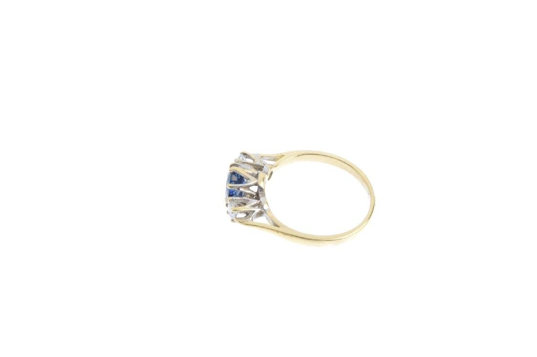 An 18ct gold sapphire and diamond ring. The oval-shape - 2
