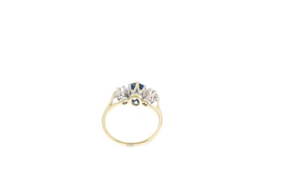 An 18ct gold sapphire and diamond ring. The oval-shape - 3