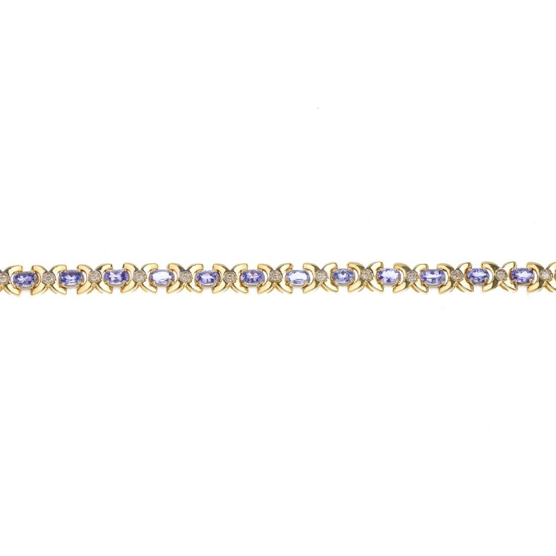 A tanzanite and diamond bracelet. Designed as a series