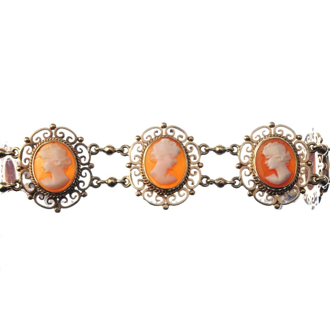 A 9ct gold shell cameo bracelet. Designed as a series