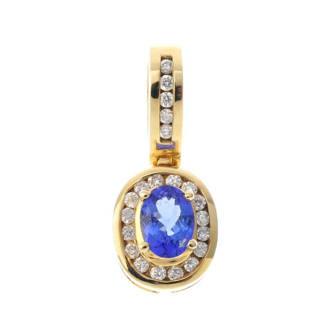 A tanzanite and diamond pendant. The oval-shape